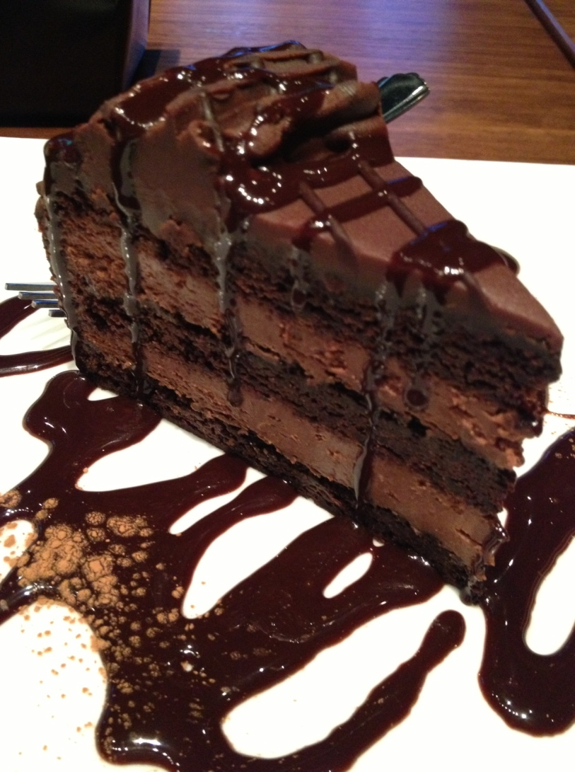 generous slice of our scrumptious, triple layer chocolate cake ...